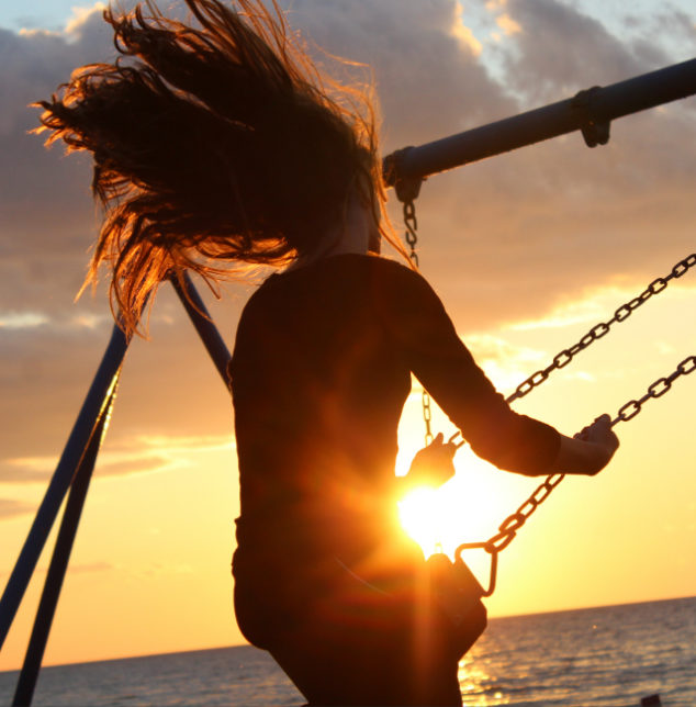 person swinging at sunset image for teen therapy seek experienced hinsdale counselor