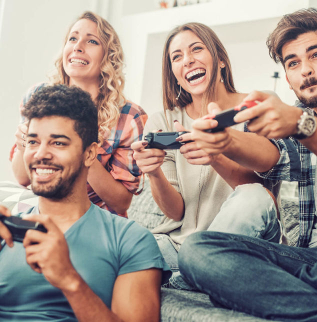 Group of friends playing video games, when seeking help with your eating disorder with Naperville depression therapist.
