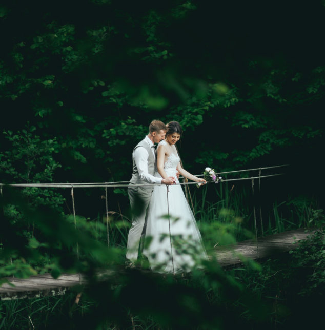 Couple on suspension bridge, is your marriage is at a critical time speak to Bolingbrook marriage counselor.